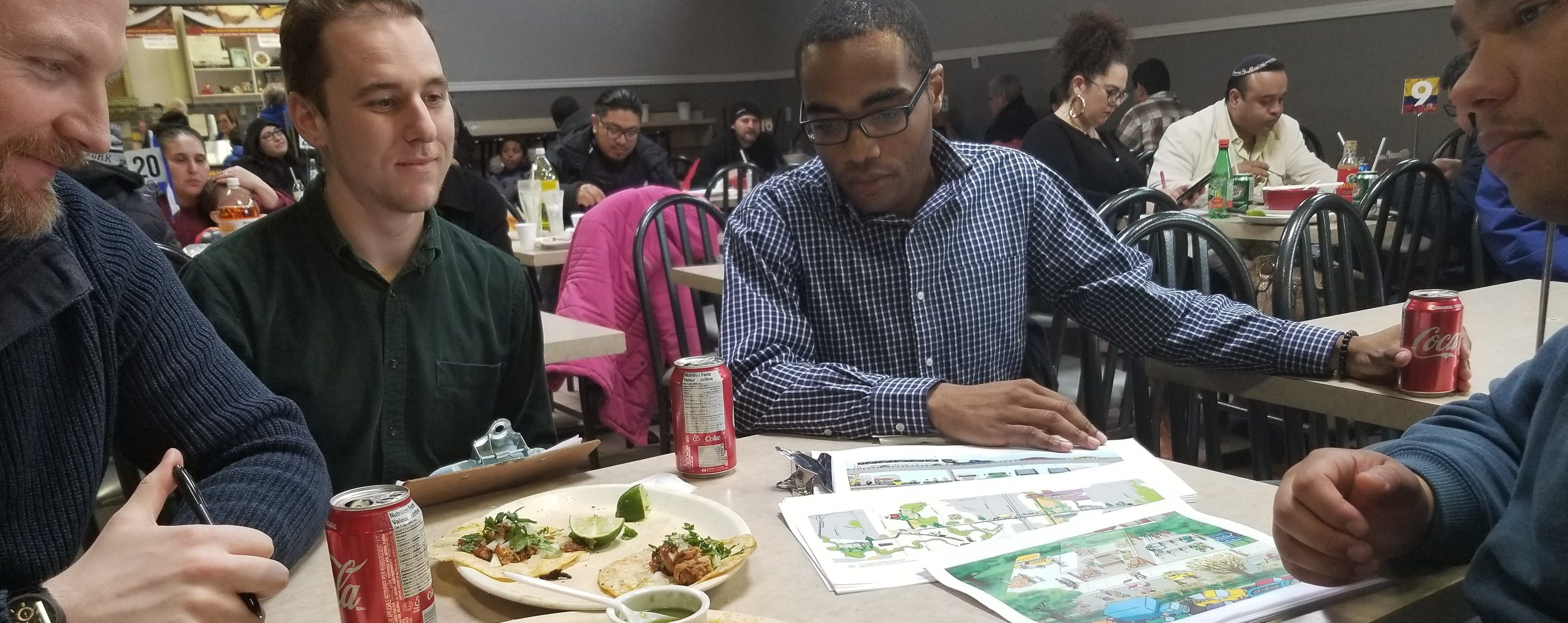Discussing the benefits of the Mobility Greenway over a meal at Plaza Latina